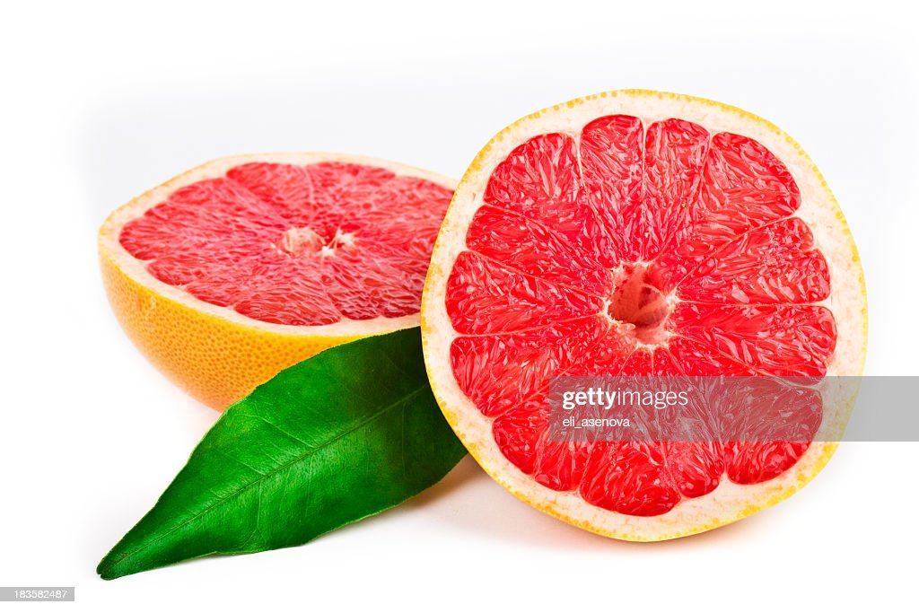 Pink grapefruit cut in half with a green leaf : Stock Photo