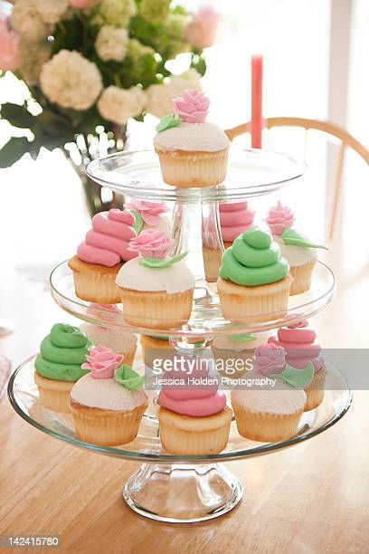 Pink, green, and white cupcakes on cupcake tree