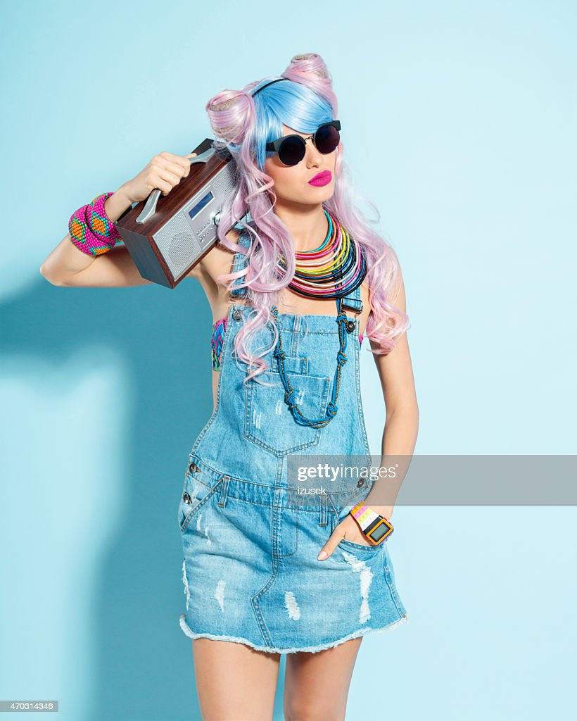 Pink hair girl in funky manga outfit holding radio : Stock Photo