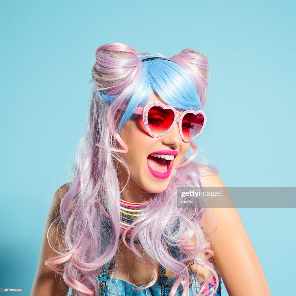 Pink hair girl in funky manga outfit wearing sunglasses : Stock Photo