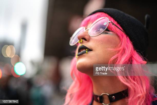 pink hair manga girl portrait - female body piercing stock photos and pictures