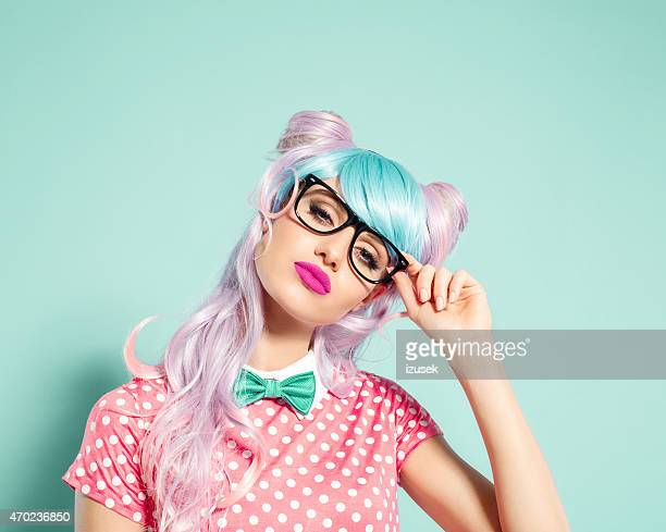 pink hair manga style girl holding nerd glasses - anime stock photos and pictures
