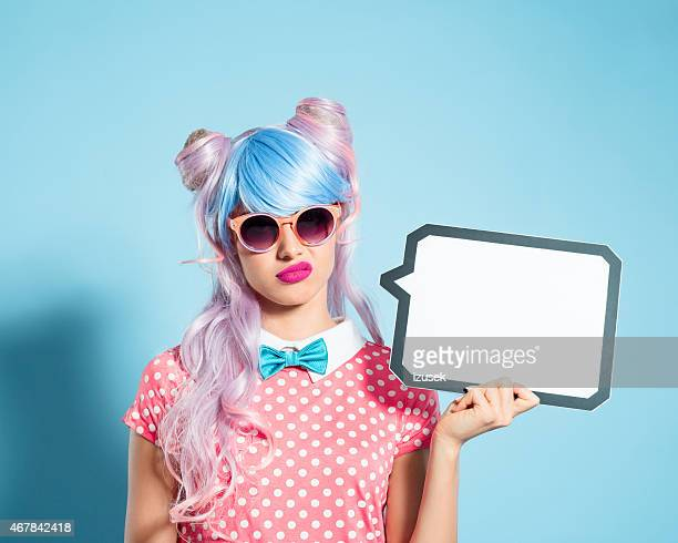 pink hair manga style girl holding speech bubble - anime stock photos and pictures
