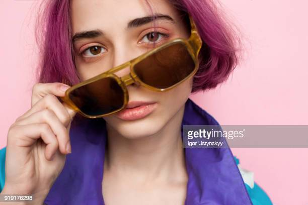 pink hair manga style girl holding sunglasses - purple hair stock photos and pictures