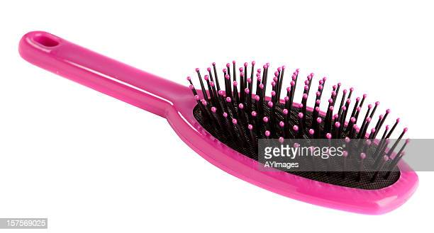 Pink hairbrush on white