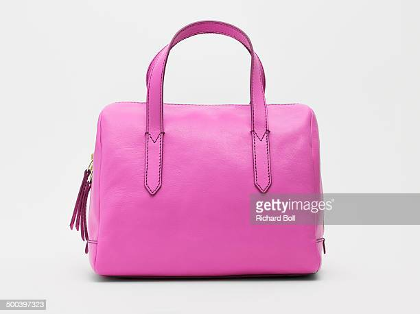A pink handbag against a white background