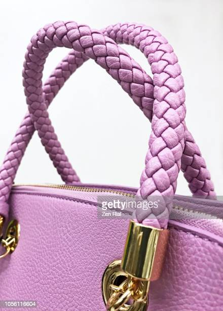pink handbag shows braided handles and metal accessories - leather purse stock pictures, royalty-free photos & images