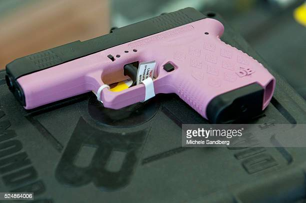 Pink handgun being sold at the store 2013 April 18 Local Guan Pawn Shop Sales Are Up And Inventory Is Down