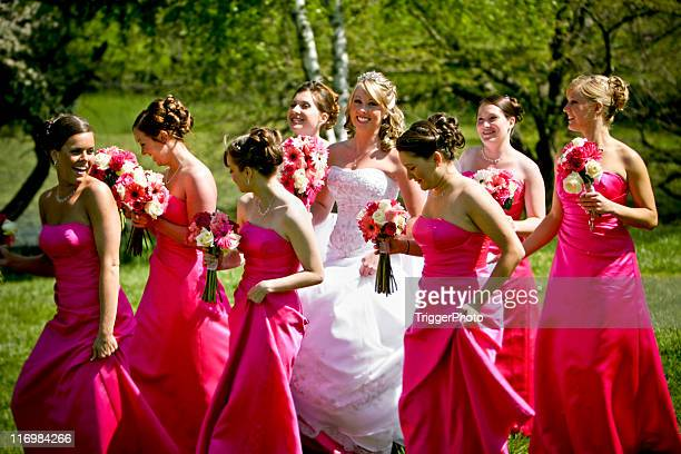 pink happy bride and bridesmaids wedding dress - wedding role stock photos and pictures