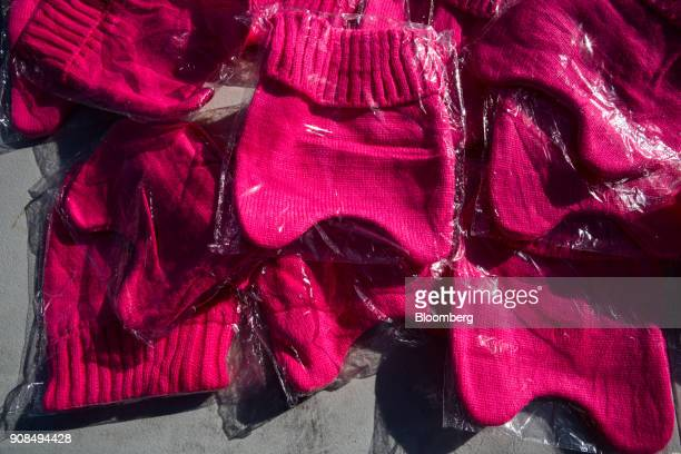 Pink hats are displayed for sale outside of the Sam Boyd Stadium during the Women's March OneYear Anniversary Power To The Polls event in Las Vegas...