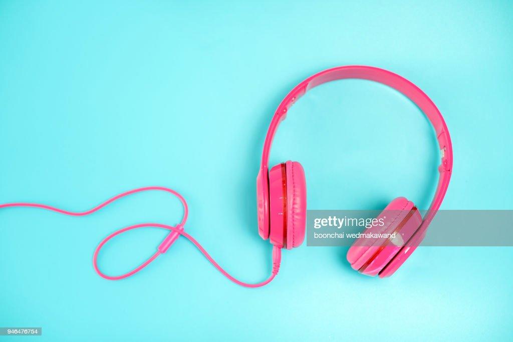 pink headphone on light Blue background,vintage or pastel concept : Stock Photo