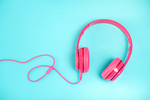 pink headphone on light Blue background,vintage or pastel concept - gettyimageskorea