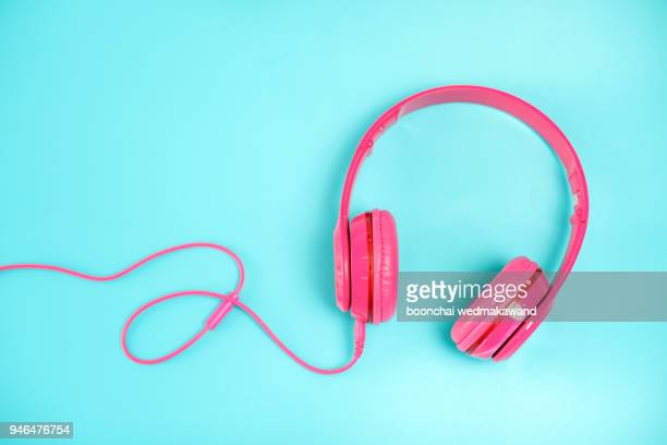 pink headphone on light blue background,vintage or pastel concept - music photos et images de collection