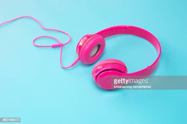 pink headphones on blue background. - funky foto e immagini stock