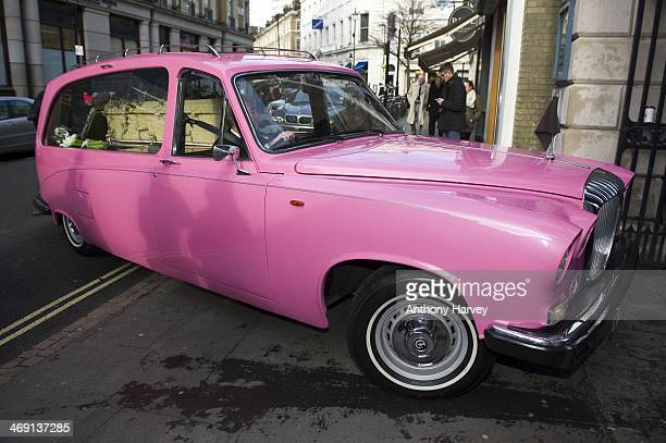 A pink hearse carrying the coffin of actor Roger LloydPack arrives at St Paul's Church in Covent Garden on February 13 2014 in London England