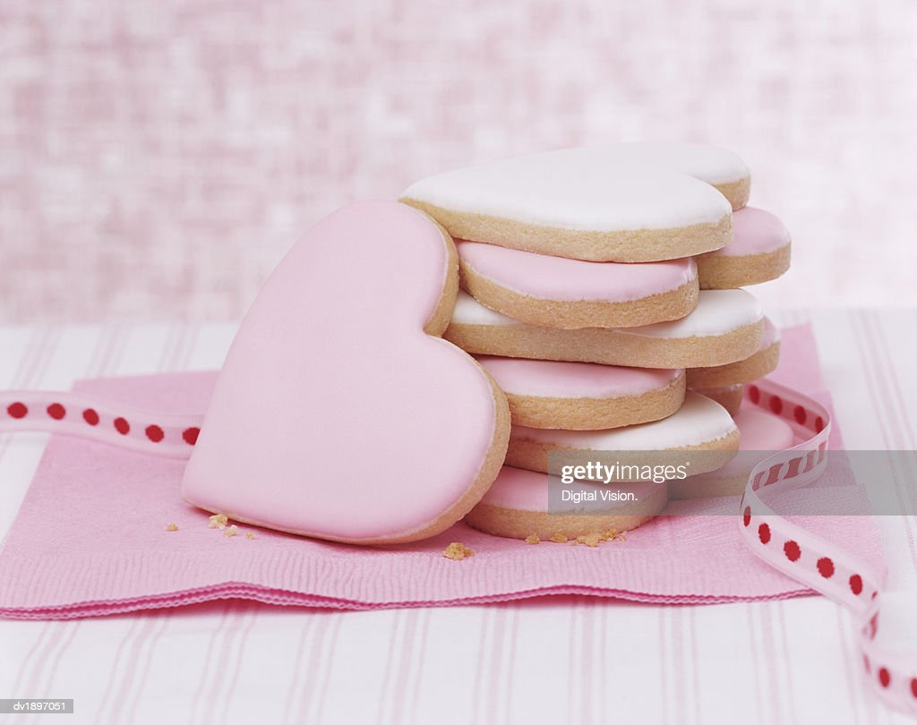 Pink Heart Shaped Cookies and a Ribbon on a Napkin : Stock Photo