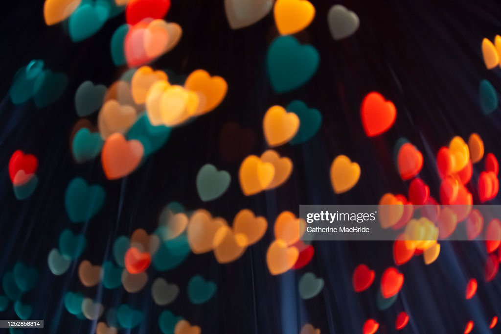 Pink heart shaped light bokeh : Stock Photo