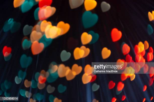 pink heart shaped light bokeh - catherine macbride foto e immagini stock