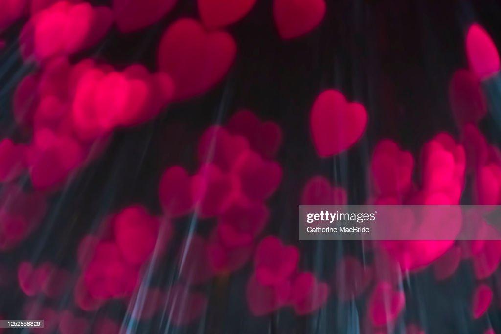 Pink heart shaped light bokeh : Stock Photo