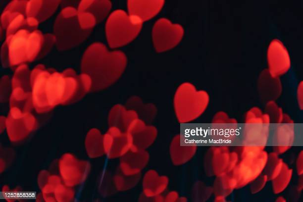 pink heart shaped light bokeh - catherine macbride stock pictures, royalty-free photos & images