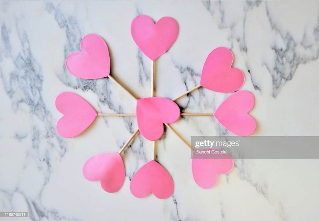 Pink Hearts Forming A Circle On A Marble Background High Res Stock Photo Getty Images