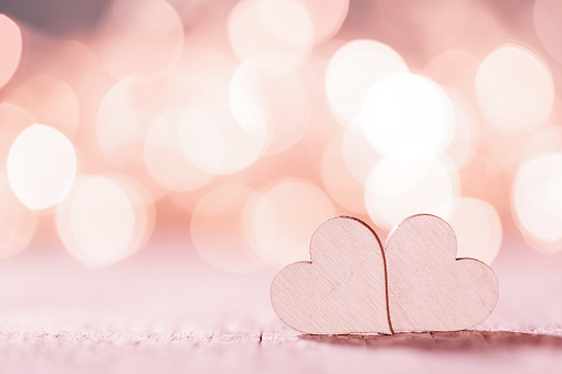 Pink hearts on bokeh background 1096877466