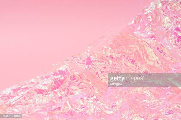 pink holographic foil - pink background stock pictures, royalty-free photos & images