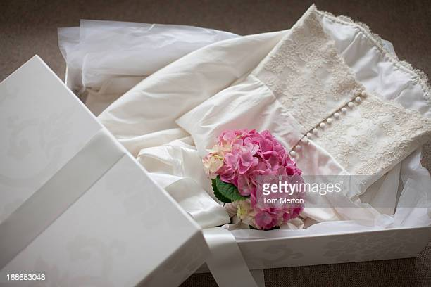 Pink hydrangea on wedding dress  in box