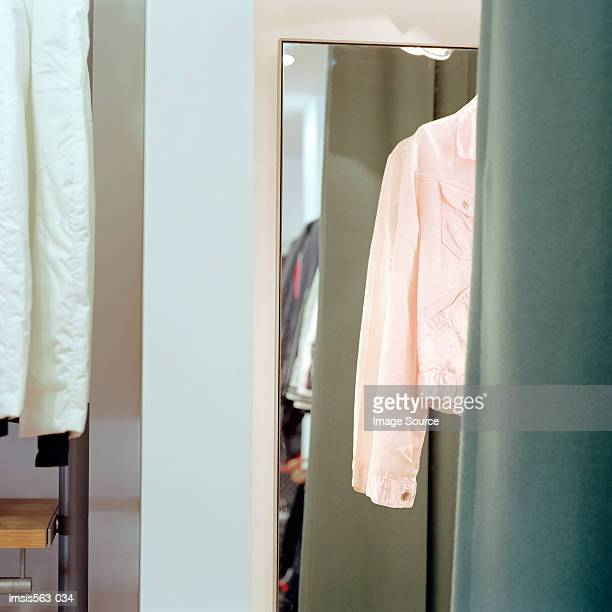 pink jacket in fitting room - fitting room stock pictures, royalty-free photos & images