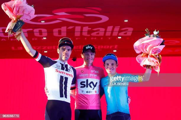 Pink jersey and winner Britain's rider of team Sky Christopher Froome poses with 2nd placed Netherlands' rider of team Sunweb Tom Dumoulin and third...