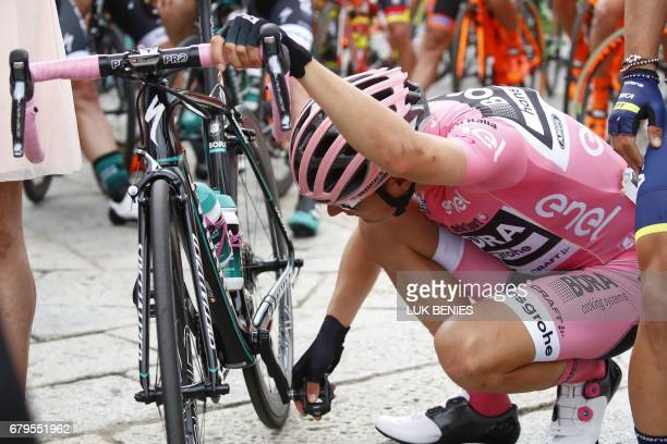 Pink jersey Austria's Lukas Postlberger of team Bora checks his bike before the start of the second stage of the 100th Giro d'Italia Tour of Italy...