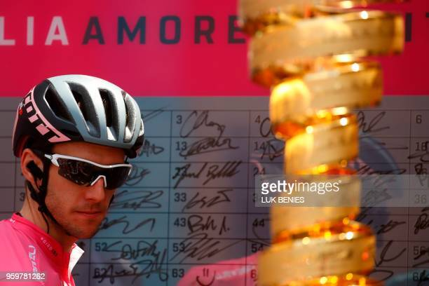 Pink jersey Britain's rider of team MitcheltonScott Simon Yates looks at the trophy before the 13th stage between Ferrara and Nervesa della Battaglia...