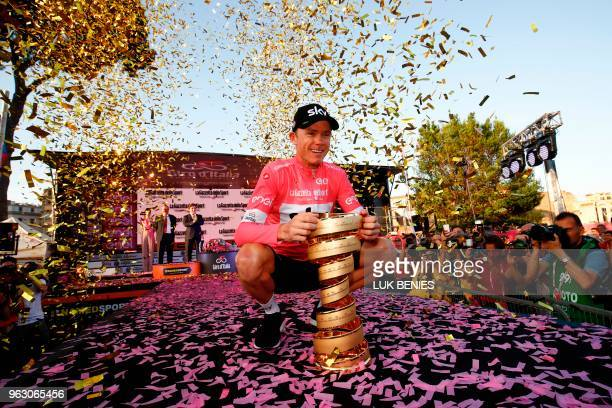 TOPSHOT Pink jersey Britain's rider of team Sky Christopher Froome winner poses with the trophy on the podium after the 21st and last stage of the...