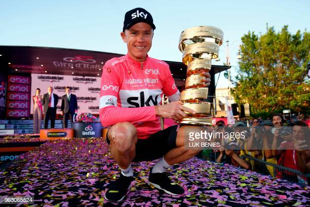 Pink jersey Britain's rider of team Sky Christopher Froome winner poses with the trophy on the podium after the 21st and last stage of the 101st Giro...