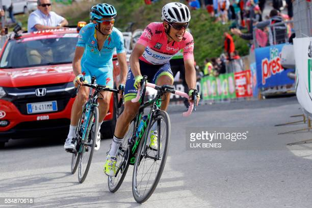 Pink jersey Colombian Esteban Chaves of Orica GreenEDGE and Italian Michele Scarponi of Astana pro team ride during the 20th stage of the 99th Giro...