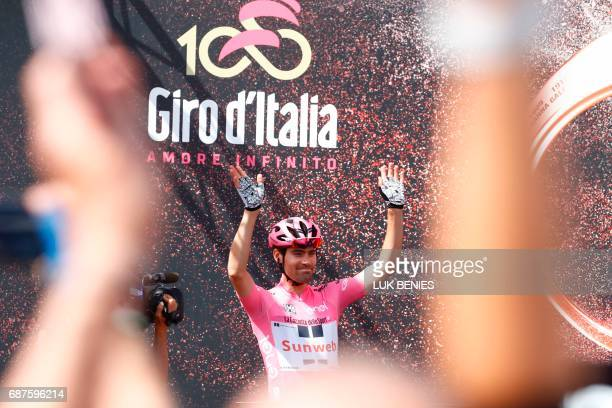 Pink Jersey Tom Dumoulin from Netherlands waves on stage before the 17th stage of the 100th Giro d'Italia Tour of Italy cycling race from Tirano to...