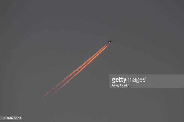 pink jetstream at sunset - jetstream stock pictures, royalty-free photos & images