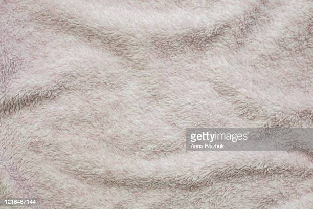 pink knitted sweater fabric as background. - cashmere stock pictures, royalty-free photos & images