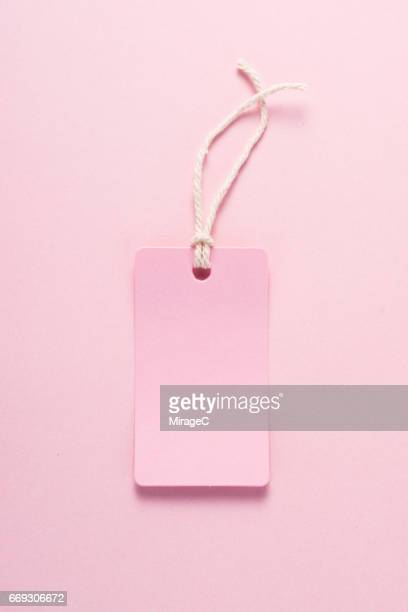 pink label on pink colored background - gift card imagens e fotografias de stock
