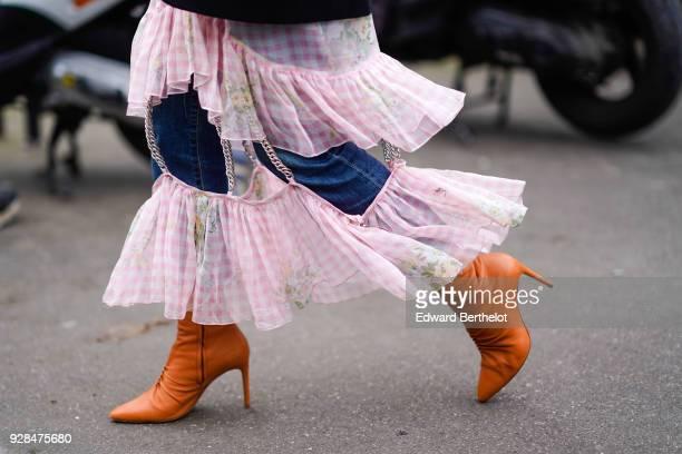 A pink lace dress orange boots outside Miu Miu during Paris Fashion Week Womenswear Fall/Winter 2018/2019 on March 6 2018 in Paris France