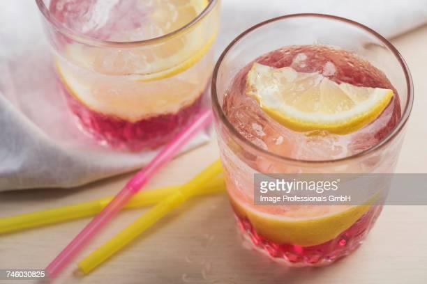 Pink lemondade with ice cubes and Meyer lemons