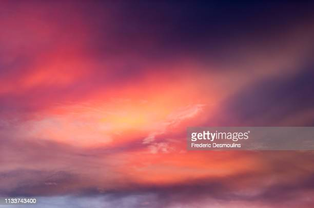 pink light in the sky - forme stock photos and pictures