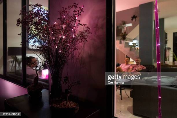A pink light is displayed in a house in a show of support to the LGBTQ community on June 27 2020 in Singapore Due to the ongoing coronavirus pandemic...