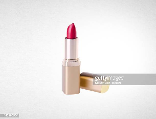 pink lipstick against white background - pink lipstick stock photos and pictures