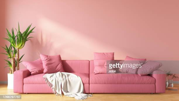 pink living room with sofa - pink colour stock pictures, royalty-free photos & images