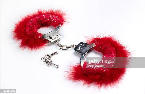 pink locked handcuffs for adult games - sadomasoquismo fotografías e imágenes de stock