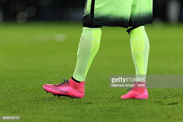 Pink Nike football boots of Aleksandar Kolarov of Manchester City during the Barclays Premier League match between Leicester City and Manchester City...