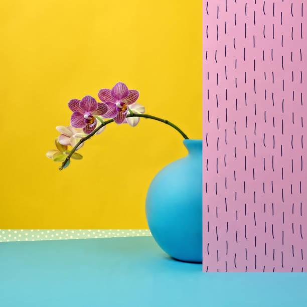Pink orchid in blue vase