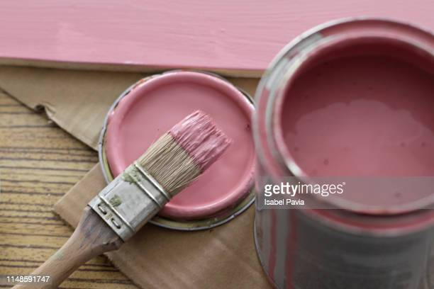 pink paint can with brush on pink background - wallpaper roll stock pictures, royalty-free photos & images