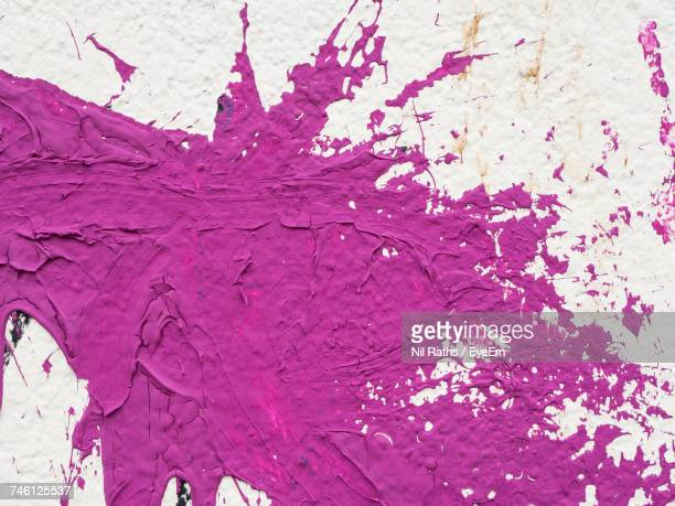 Pink Paint Splattered On White Wall